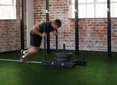 Gym turf is a durable and long-lasting option that is perfect for pulling or pushing sleds, completing your CrossFit WOD or performing HIIT workouts. Learn more about sports turf.