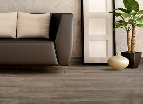 FlooringInc Bel-Air Windwood Laminate Flooring in living room setup