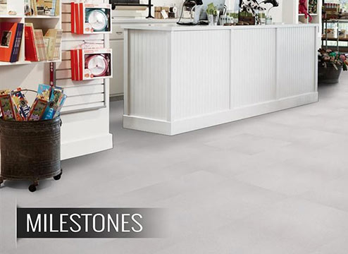 White luxury vinyl floor tiles in commercial setting