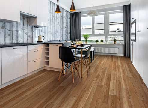 Wood-look luxury vinyl floor planks with dog in a laundry room