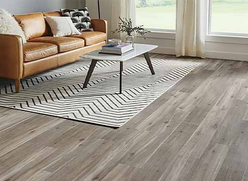 Blonde wood wpc flooring in modern kitchen and dining area