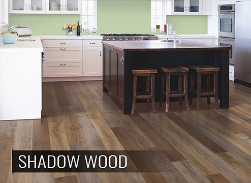 High variation wood-look vinyl plank flooring in modern kitchen
