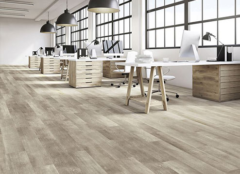 Luxury vinyl plank flooring in modern, open office space