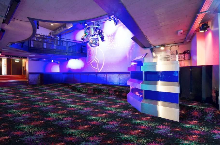 Joy Carpets Neon Lights Grand Finale Tile - Under natural light