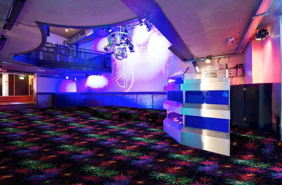 Joy Carpets Neon Lights Grand Finale Tile - Under black light